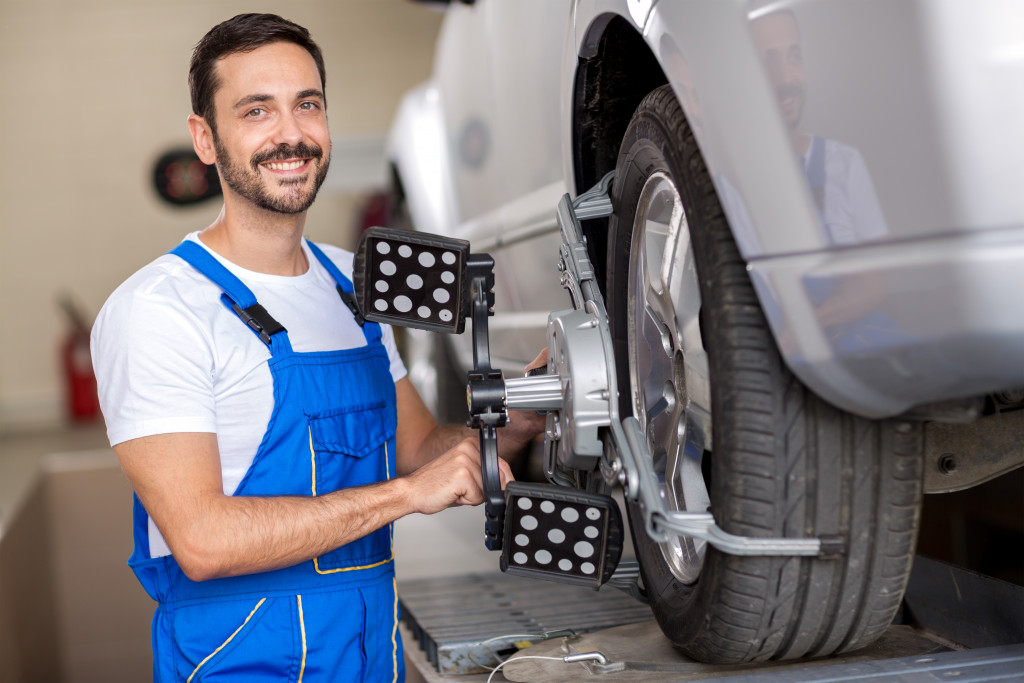 man fixing a car