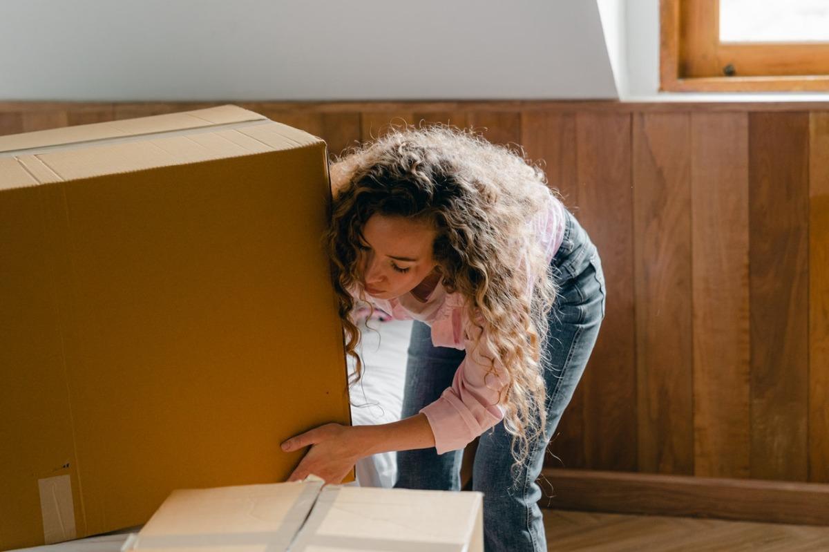 woman lifting a box